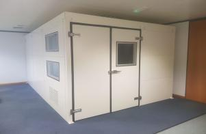 Indoor acoustic enclosure within an educational setting